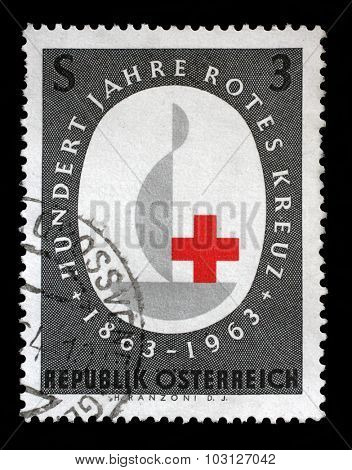 AUSTRIA - CIRCA 1963: A stamp printed in the Austria is dedicated to the 100th anniversary of the International Red Cross, circa 1963