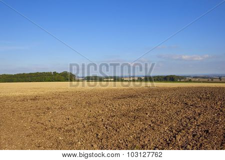 Plowed Field With Wind Turbine