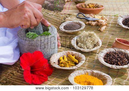 Man Preparing Ayurvedic Medicine