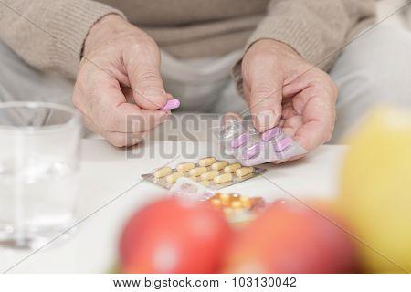 Elderly Man Holding Packaging
