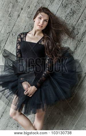 Portrait of a beautiful belt brunette ballerina in tutu