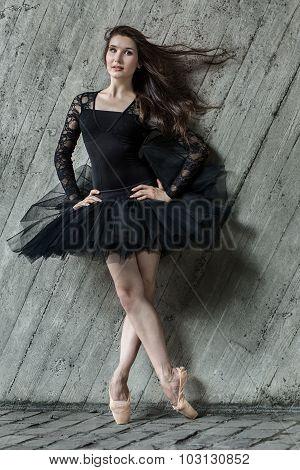 Portrait in full of beautiful brunette ballerina