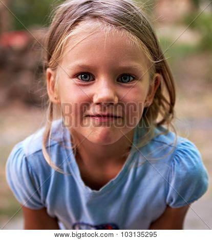 Little Blond Girl Portrait Outdoors