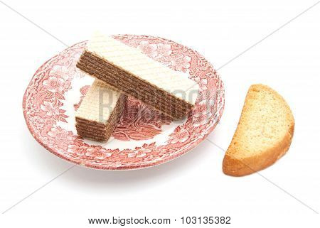Two Wafers On A Plate And Cracker