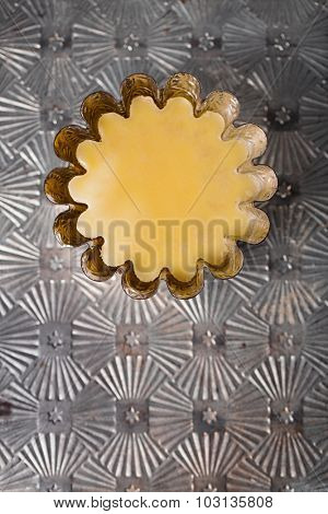 ghee or melted butter on metal background