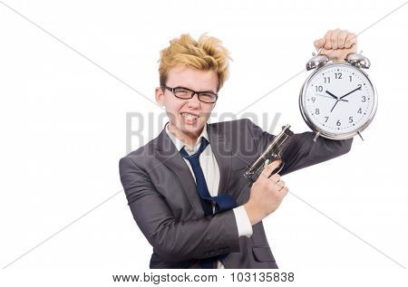 Young businessman holidng gun and alarm clock isolated on white