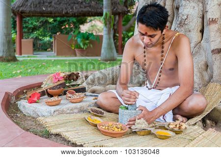Man Preparing Ayurvedic Medicine