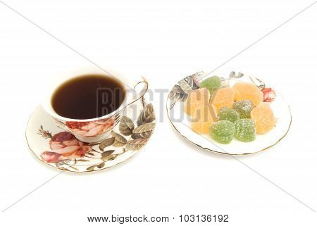 Cup Of Tea And Fruit Candies