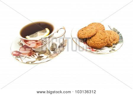 Cup Of Tea With Lemon And Oatmeal Cookies