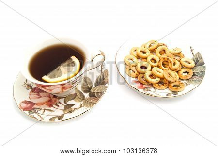 Bagels And Tea With Lemon On White