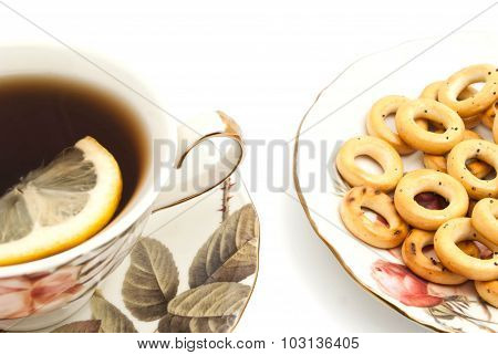Bagels And Cup Of Tea With Lemon On White