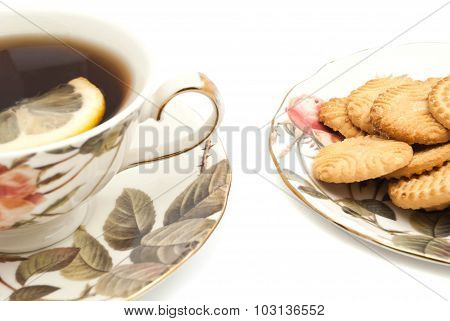 Mug Of Tea With Lemon And Delicious Cookies