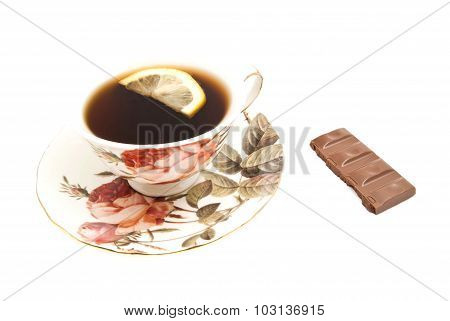Mug Of Tea With Lemon And Chocolate Bar