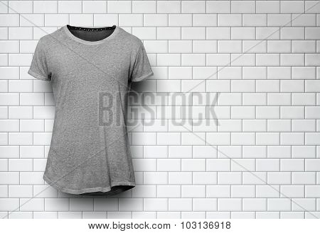 Gray tshirt isolated and wall of the bricks background