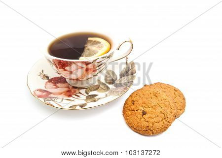 Oatmeal Cookies And Cup Of Tea With Lemon