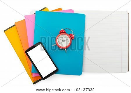 Notebooks and alarm clock