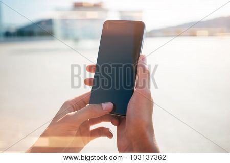 Mock up of girl using her smartphone for travel