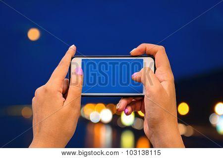 Hands holding smartphone