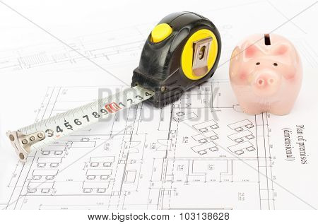 Tape measure with piggy bank, close up view