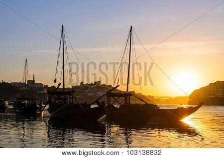 sunset view of traditional boats and Douro river in Porto, Portugal