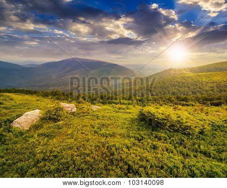 Slope With White Boulders In Mountains At Sunset