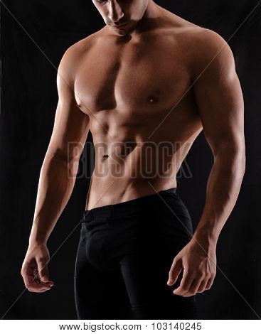 Muscle man body shape young man portrait on black background
