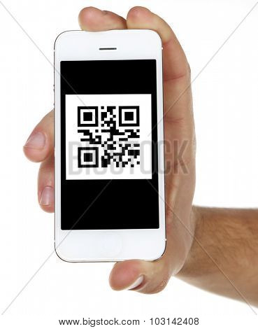 Hand holding smart phone with QR code on screen