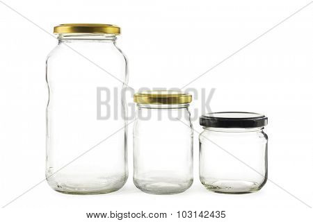 Three empty glass jars on white