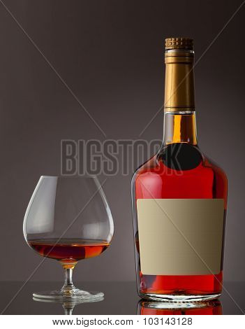Bottle of cognac and glass
