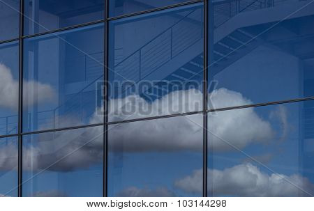 blue sky and clouds reflection in office building window