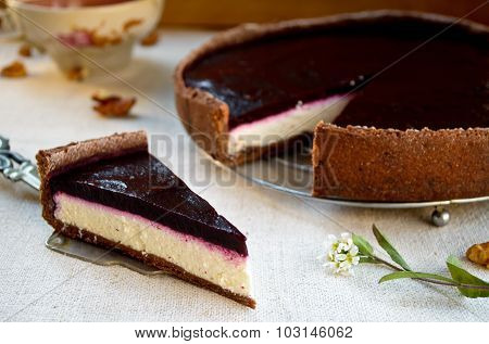 Homemade chocolate cream tart with blackberry jelly and walnuts