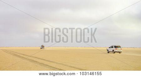 Tourists Driving through the Desert
