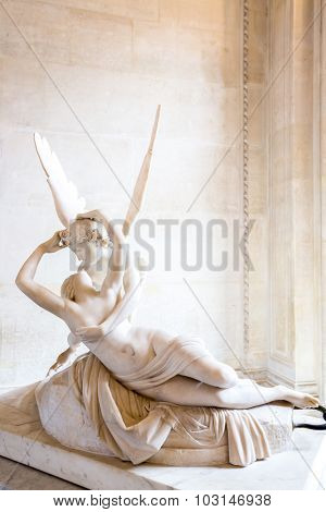 Paris - June 23: Cupid statue on June 23, 2014 in Paris. Antonio Canova's statue Psyche Revived by Cupid's Kiss, first commissioned in 1787, exemplifies the Neoclassical devotion to love and emotion.