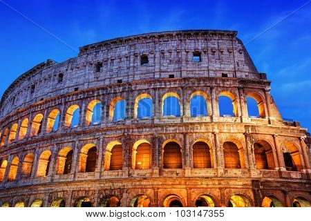 Colosseum in Rome, Italy. Symbol of the ancient city. Amphitheatre in sunset light.