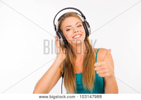 Pretty Girl Showing Thumb Up And Listening To The Music