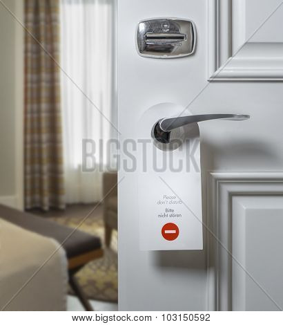 Do Not Disturb sign on hotel room's door handle