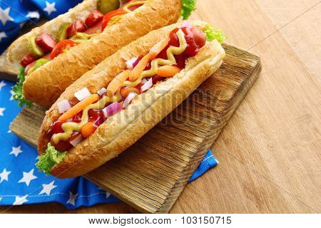Fresh hot dogs on wooden background