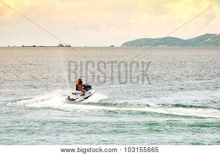 People Riding Jet Ski In The Sea