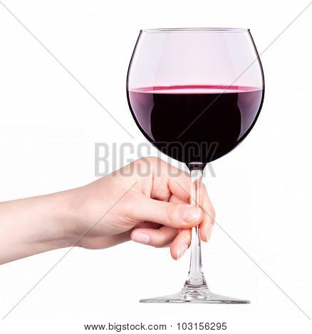 Glass of red wine with splashes in hand isolated