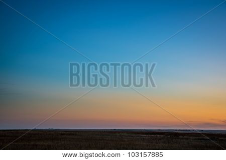 typical clear sky after sunset over Colorado prairie with dusk colors