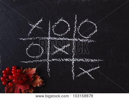 Game Tic Tac Toe On Black Slate Board
