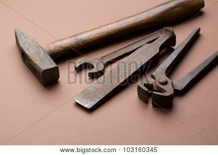 set of old dirty tools on red background