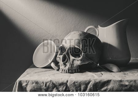 Still Life Black And White Photography With Human Skull And Ceramic Tableware On Table