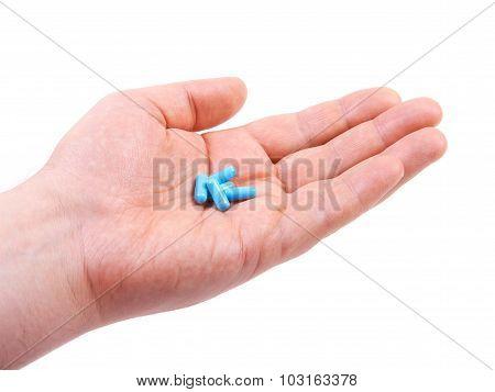 Hand holding pills.