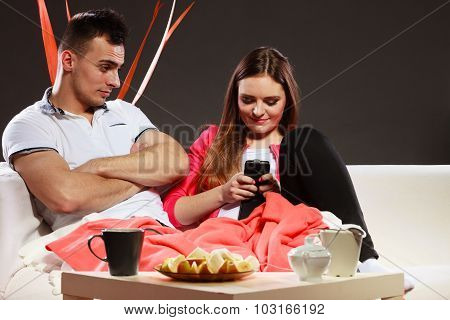 Couple Using Mobile Phone Texting Messages