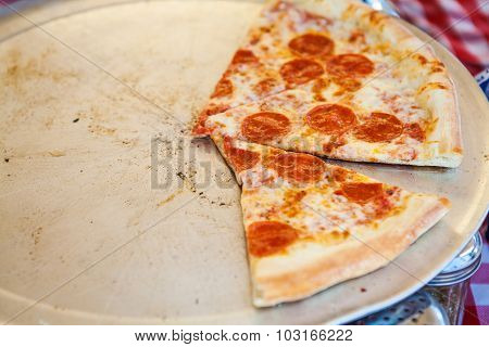 Pizza on baking sheet in street fast food cafe.