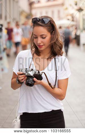 Brunette Beauty Taking Photo.