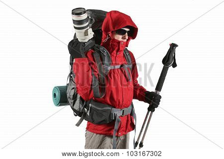 Tourist In A Red Jacket With A Camera And Trekking Poles