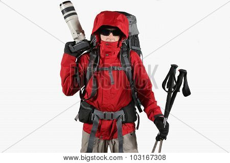 A Tourist In A Red Jacket With A Backpack, Trekking Poles And A Camera