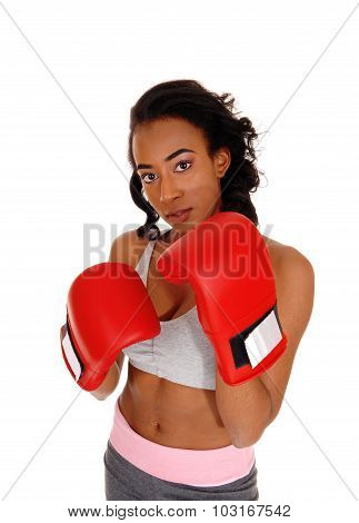 African American Woman Wearing Boxing Gloves.